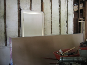 drywall before: insulation in front parlor